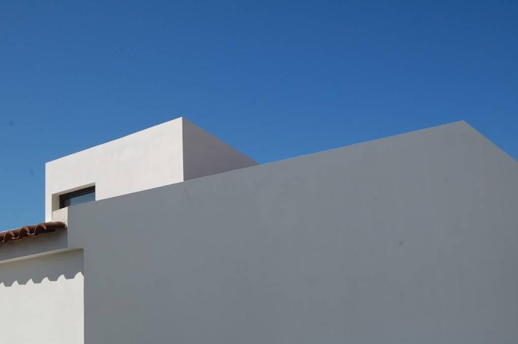 Minimalist house by Coxim Creative Factory Minimalist