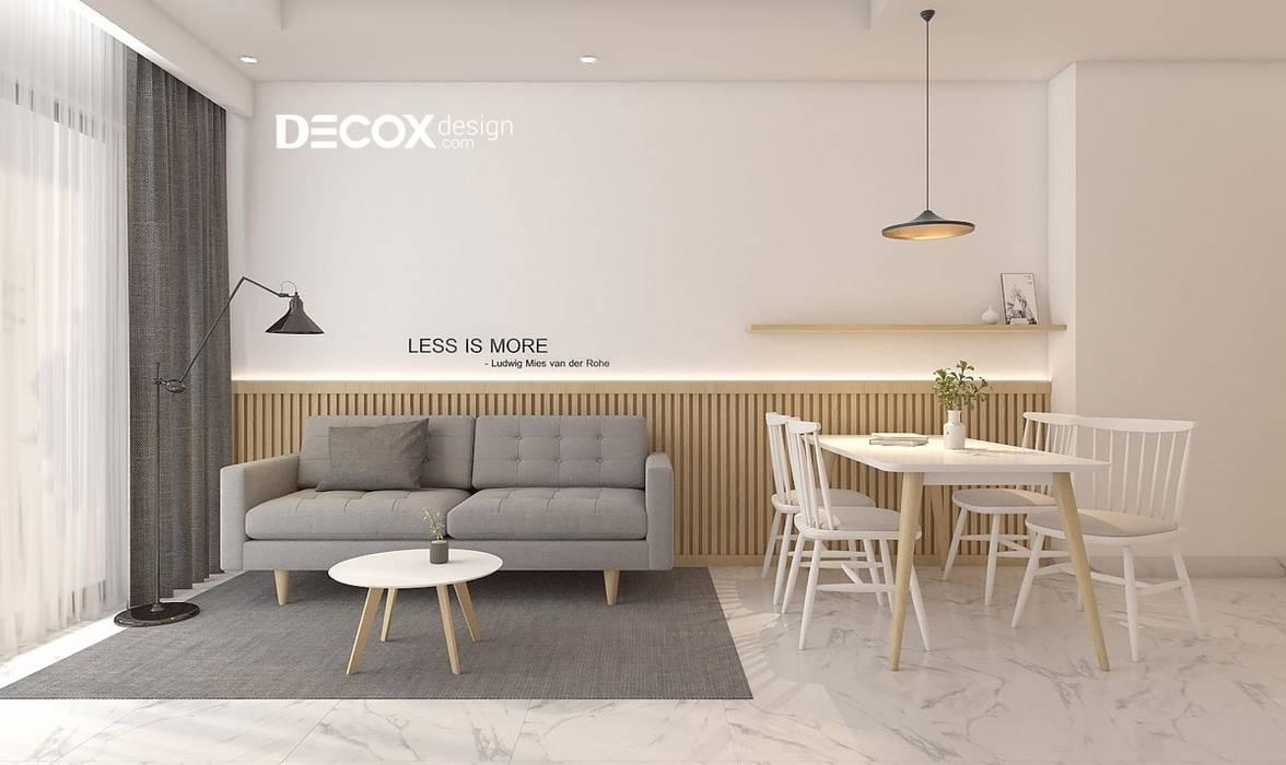 THIẾT KẾ NỘI THẤT CĂN HỘ SAIGON MIA 66M2 DE020 Phòng khách phong cách tối giản bởi Công ty cổ phần nội thất DECOX Tối giản
