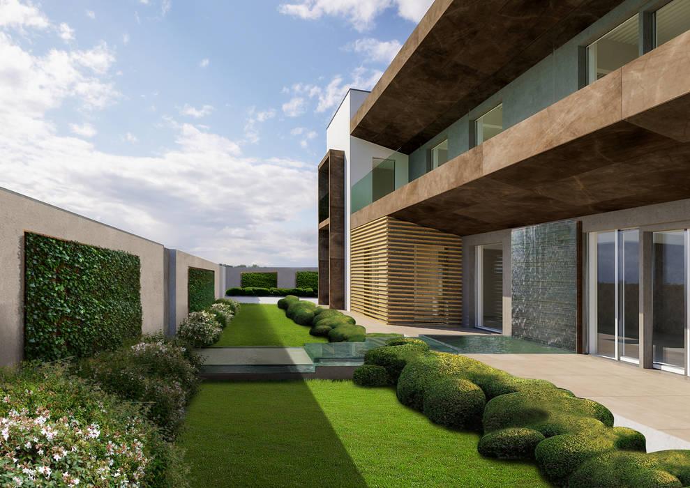 L'entrata con la cascata a muro di Verde Progetto - Adriana Pedrotti Garden Designer Moderno