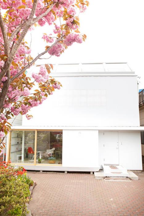 Casas de estilo ecléctico de KAWANOJI Ecléctico