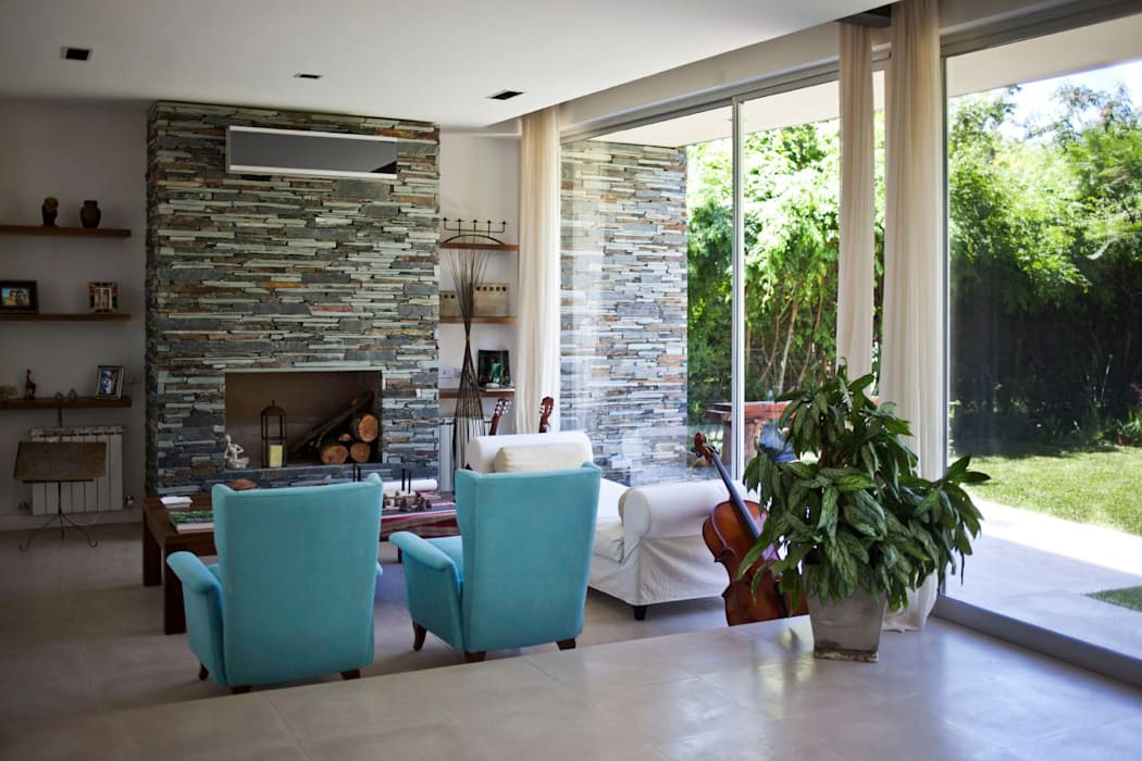 Casa Unifamiliar Atlántico Arqs Comedores modernos de atlantico estudio de arquitectura y construccion Moderno Piedra