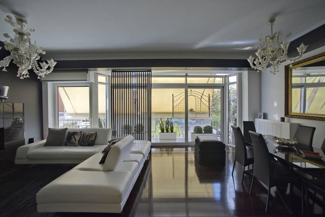 il soggiorno Soggiorno moderno di Altro_Studio Moderno Legno Effetto legno