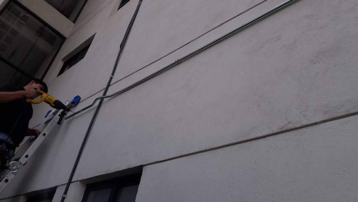 SISTEMA DE CCTV Paredes y pisos de estilo industrial de INTEGRADORES DE TECNOLOGIAS AVANZADAS Industrial