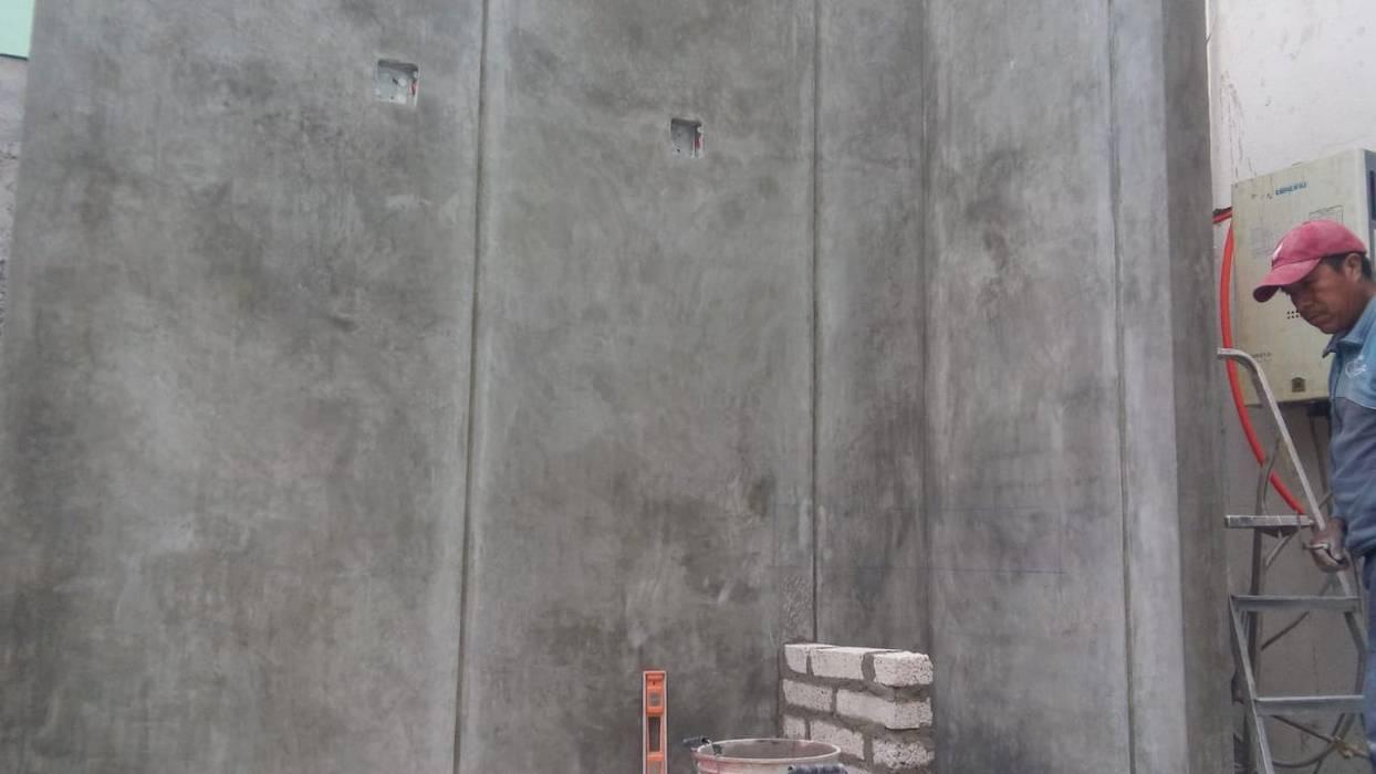 Paredes y pisos de estilo industrial de EMKA Industrial