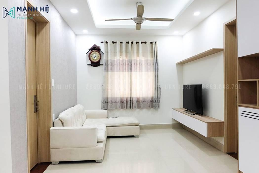 Phòng khách sáng sủa, sang trọng sau khi hoàn thành cải tạo nội thất bởi Công ty TNHH Nội Thất Mạnh Hệ Hiện đại