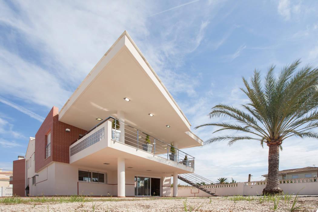 Fachada trasera. Terraza cubierta. Barreres del Mundo Architects. Arquitectos e interioristas en Valencia. Casas unifamilares