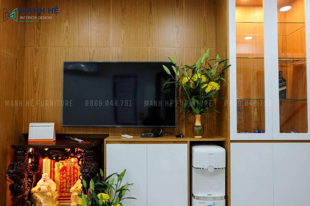 Hệ tủ kệ phòng khách được khoét lỗ làm kệ tivi sang trọng Công ty TNHH Nội Thất Mạnh Hệ Phòng khách