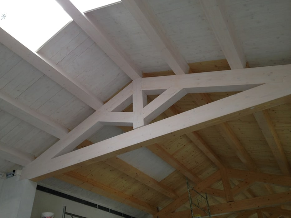 by Studio di Architettura Massimiliano Furini Classic Solid Wood Multicolored