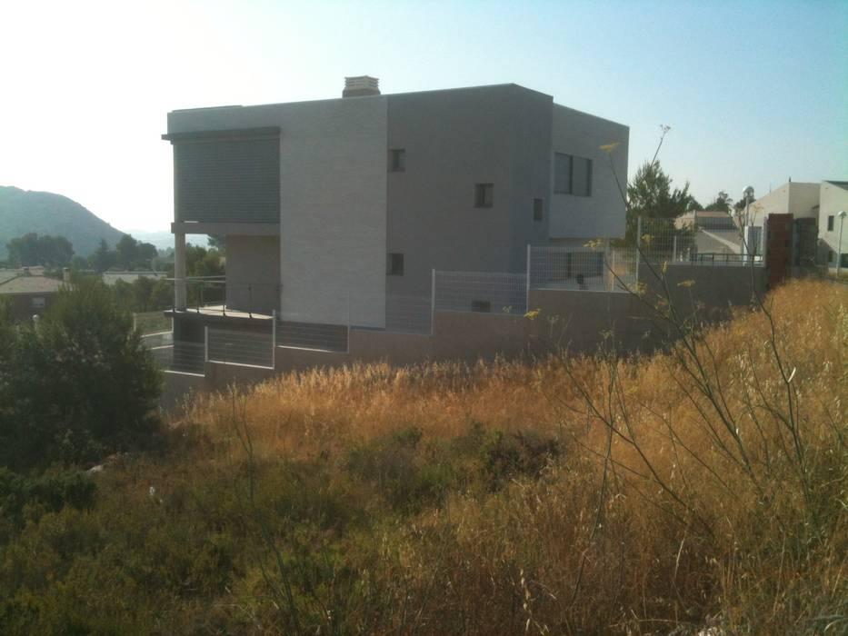 Vista exterior norte OCTANS AECO Casas de estilo moderno