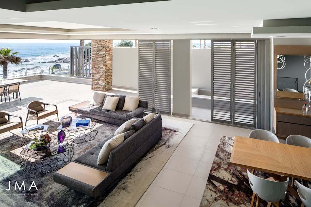Connected Atlantic Living - Living Area with views of the Atlantic Ocean Modern living room by Jenny Mills Architects Modern