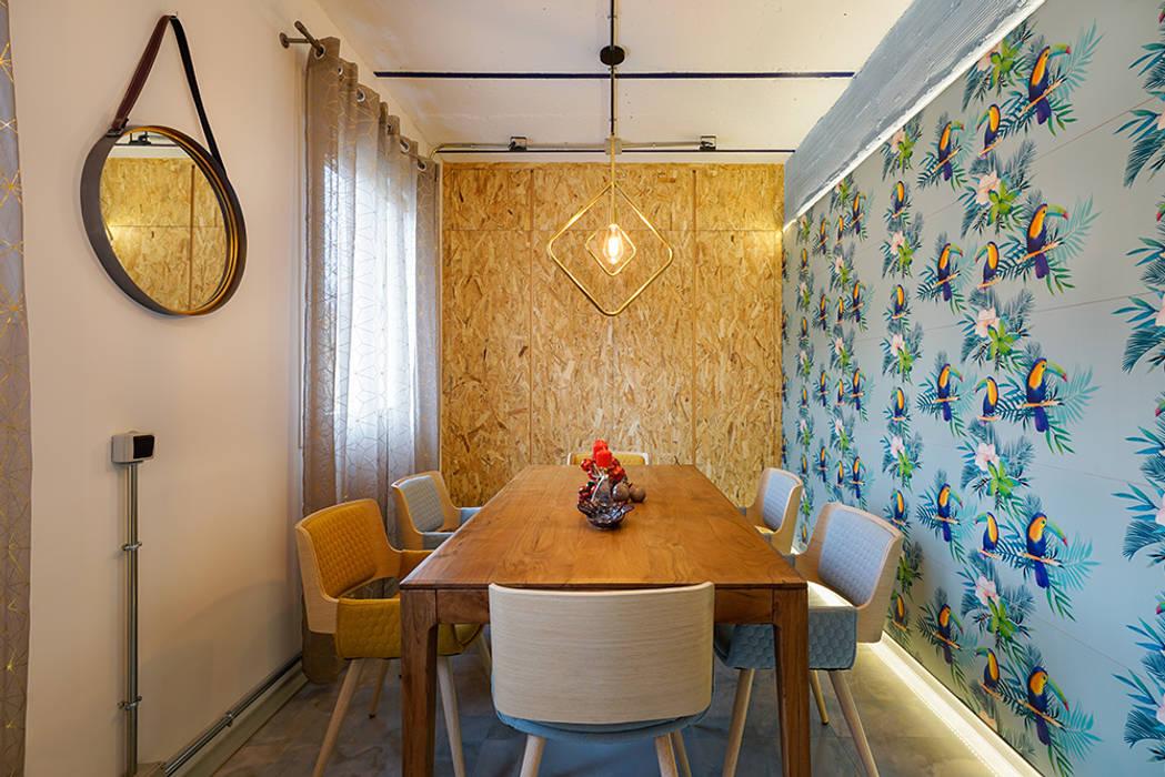 Comedor fresco y divertido en piso moderno en Madrid. Comedores de estilo moderno de OOIIO Arquitectura Moderno Cerámico