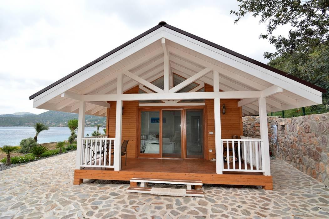 Çağlar Wood House Casas de madera Madera Acabado en madera