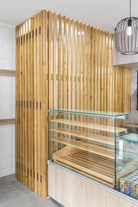 Decoração de interiores pastelaria Paredes e pisos modernos por homify Moderno
