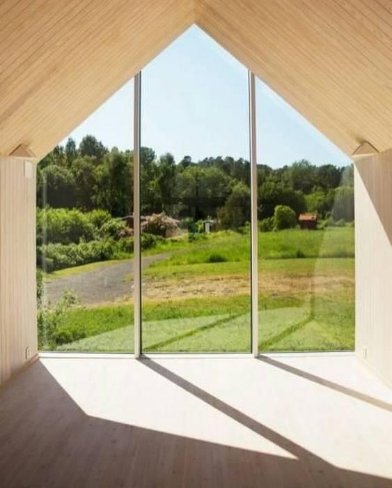 Casa in legno passiva Green Living Ltd Ingresso, Corridoio & Scale in stile moderno Legno massello