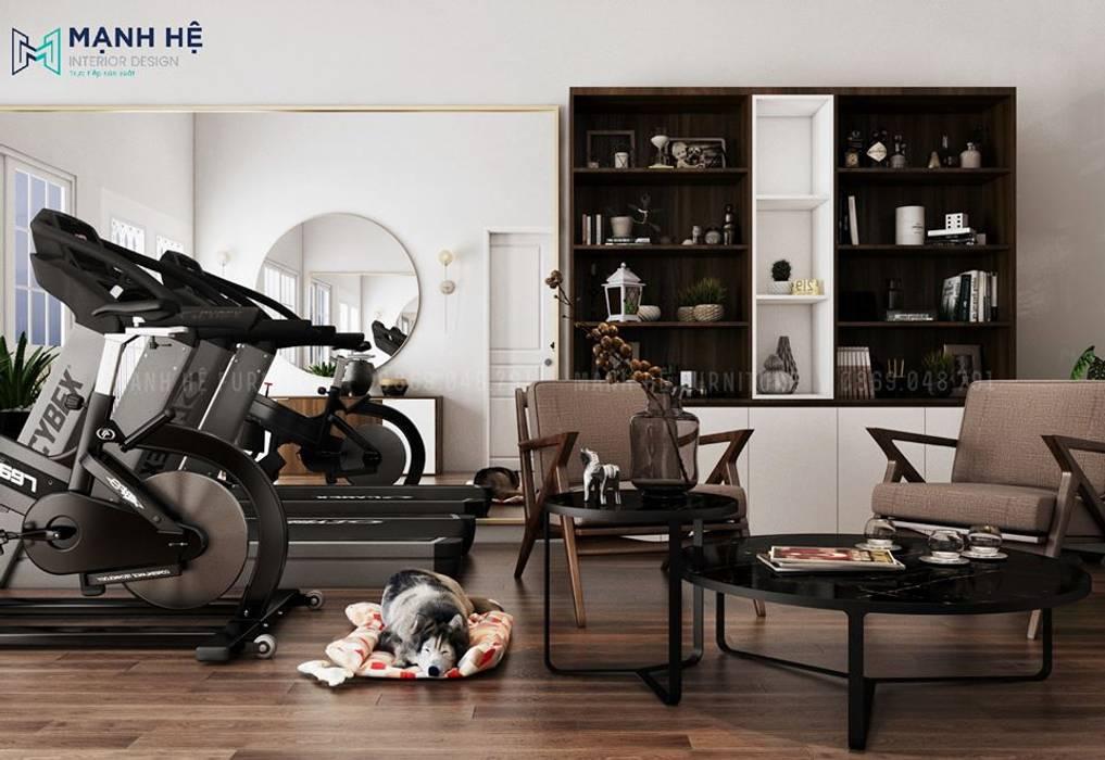 Thiết kế góc tập thể dục ngay phòng khách hiện đại bởi Công ty TNHH Nội Thất Mạnh Hệ Hiện đại