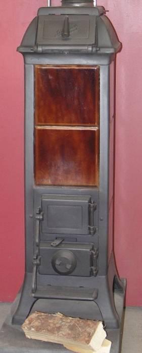 Gesamtansicht Front Perler Ofen GmbH Minimalistischer Wintergarten Metall Braun