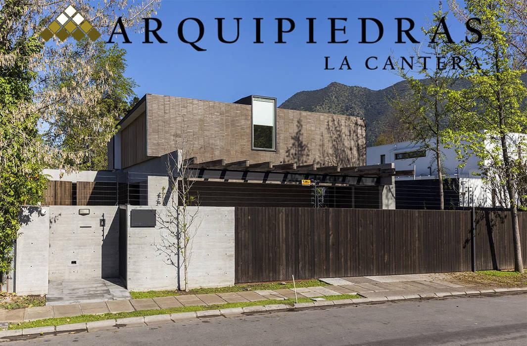 Revestimiento Muro Liso Casas de estilo rústico de Arquipiedras Rústico