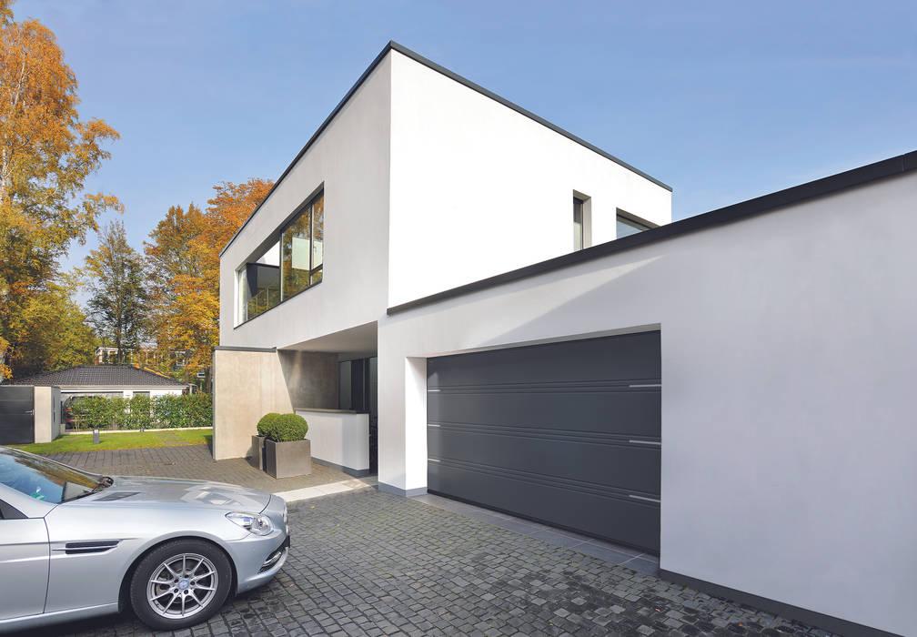 Hormann T-ribbed sectional garage door Modern style doors by Access Garage Doors Ltd Modern