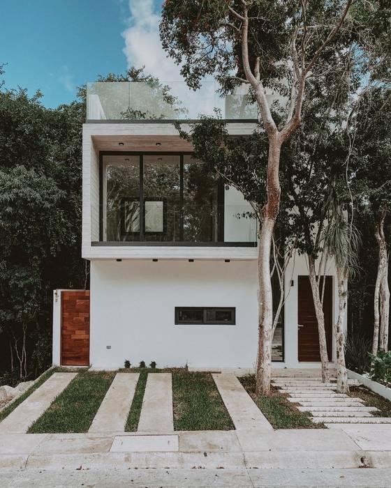 Fachada Frontal Casas minimalistas de NAOARQUITECTOS Minimalista Concreto