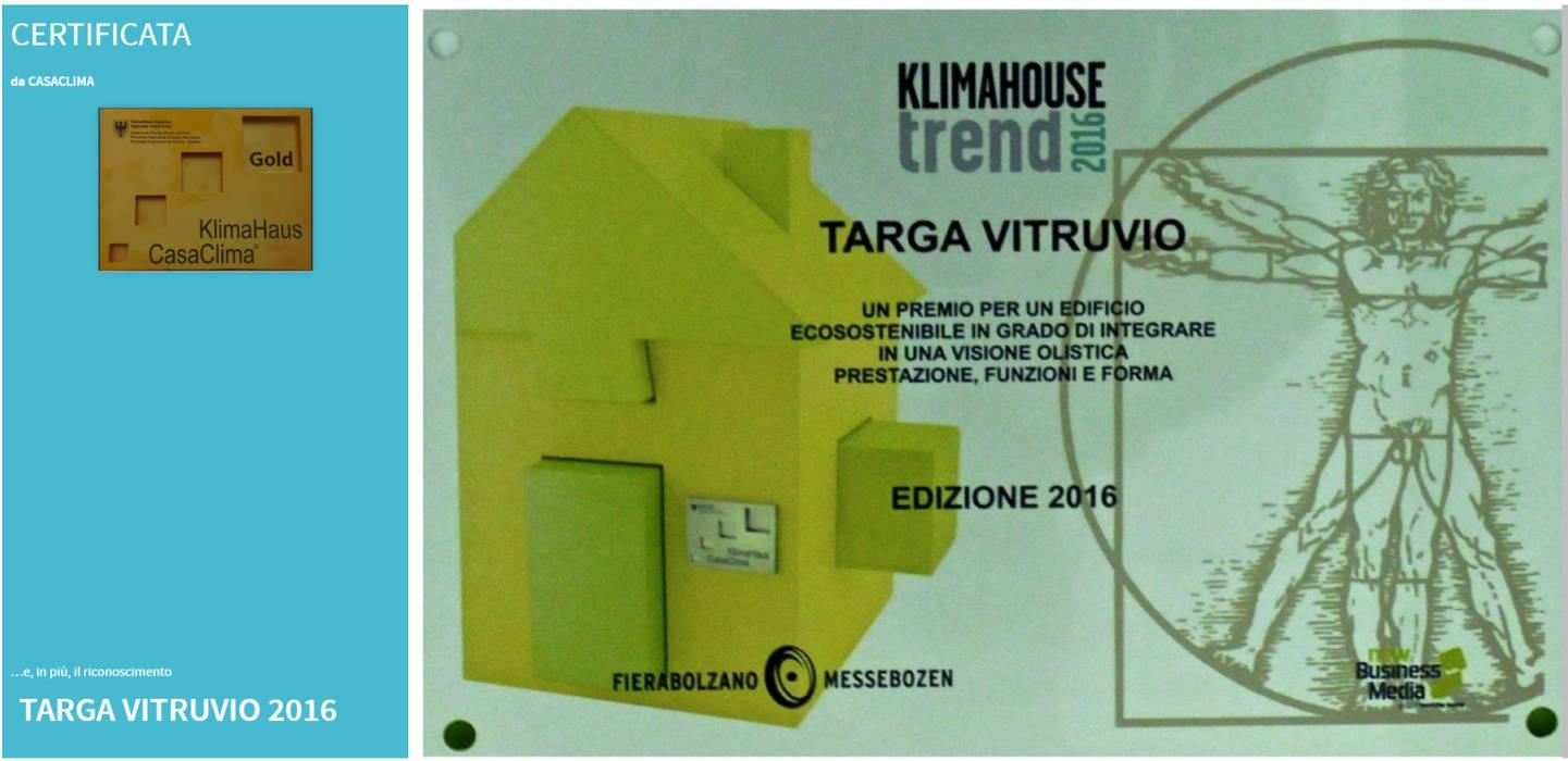 Targa edificio ecosostenibile Case moderne di C.M.E. srl Moderno