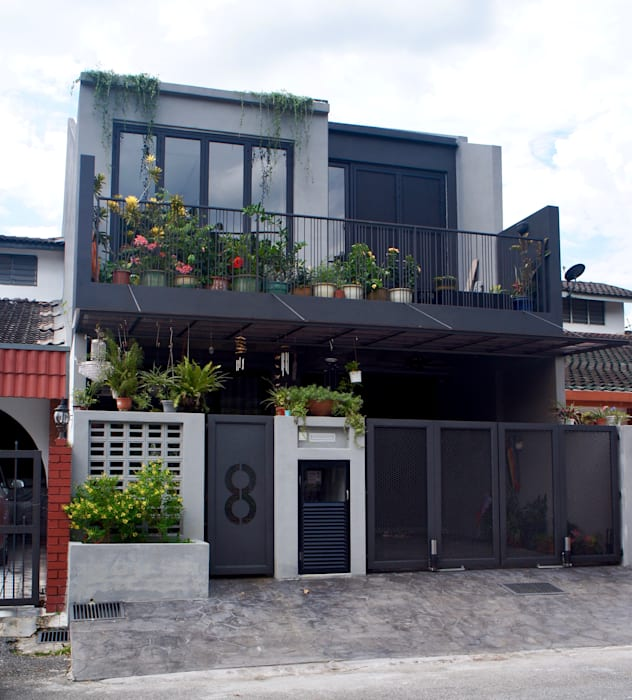Low-profile front elevation N O T Architecture Sdn Bhd Rustic style house