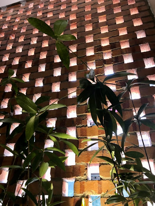 Red bricks design is carried into the interior with the japanese bamboos planted N O T Architecture Sdn Bhd Rustic style walls & floors