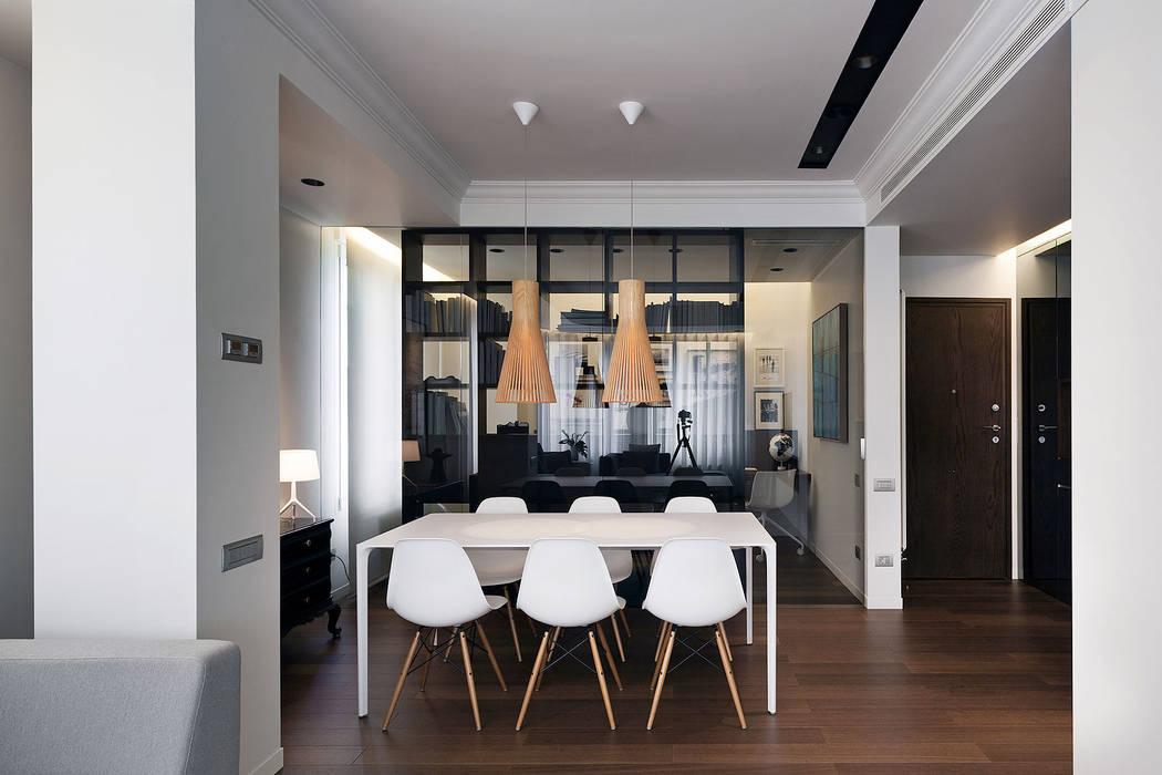 Vista desde salón al comedor y zona del estudio MANUEL GARCÍA ASOCIADOS Comedores de estilo moderno Marrón