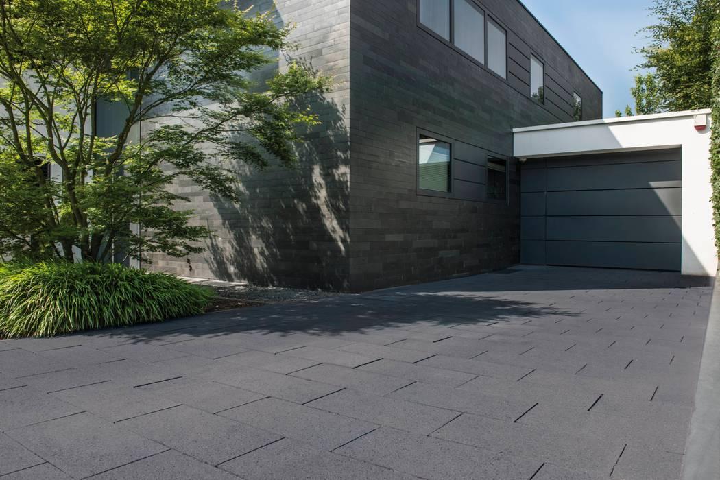 Alles außer Standard. Moderne Garagen & Schuppen von METTEN Stein+Design GmbH & Co. KG Modern Beton