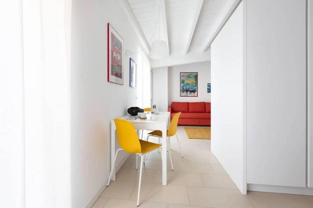 zona pranzo Filippo Zuliani Architetto Sala da pranzo moderna Ceramica Bianco