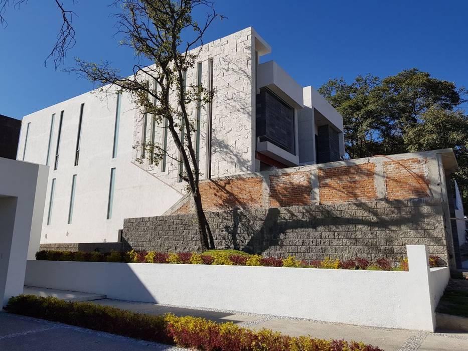 CASA NA. Arqcubo Arquitectos Casas modernas Mármol Blanco