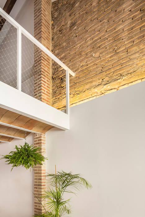 Nodopía Arquitectura y Diseño Dinding & Lantai Gaya Mediteran Batu Bata