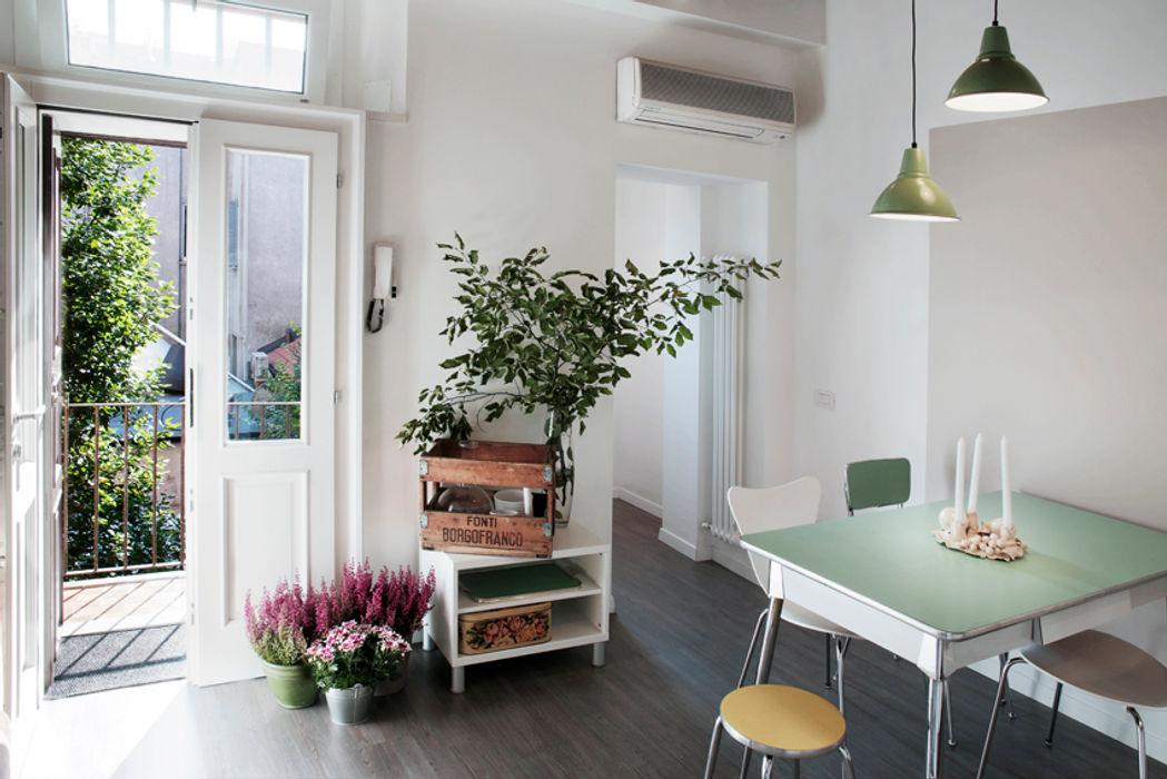 marta novarini architetto Ruang Makan Modern