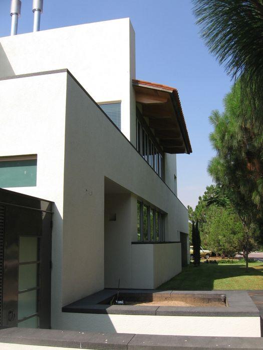 Casa en Villa Coral, 2003 Taller Luis Esquinca Casas modernas