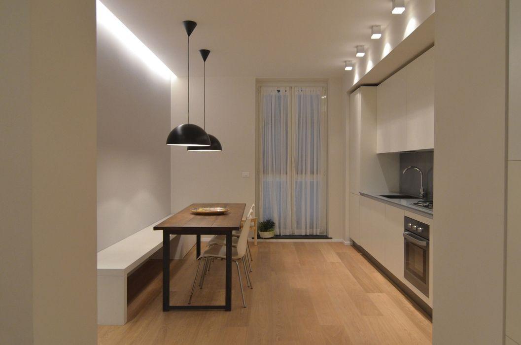 Ispirazione nordica ministudio architetti Sala da pranzo minimalista