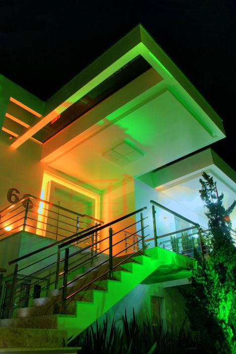 Fachada principal ANDRÉ PACHECO ARQUITETURA Casas modernas
