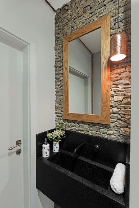 Minimalist, simple lake house design by OIKOI homify Scandinavian style bathroom Stone White