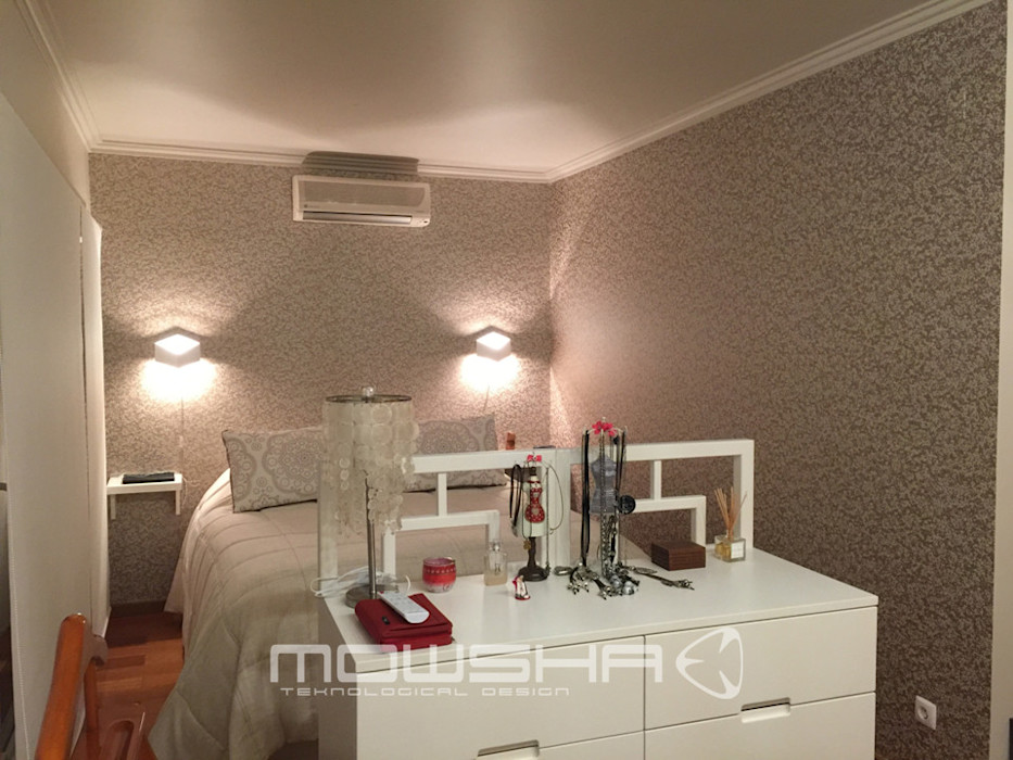 Suite Casal: áreas distintas: zona de dormir e zona de vestir Mowsha tek Design Lda