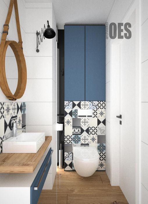 Granatowa łazienka OES architekci Nowoczesna łazienka Beton Niebieski