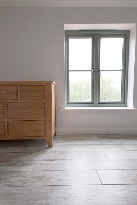 Coastal Rebuild: Pebbleshore Wood Effect Porcelain Quorn Stone Scandinavian style bedroom Tiles
