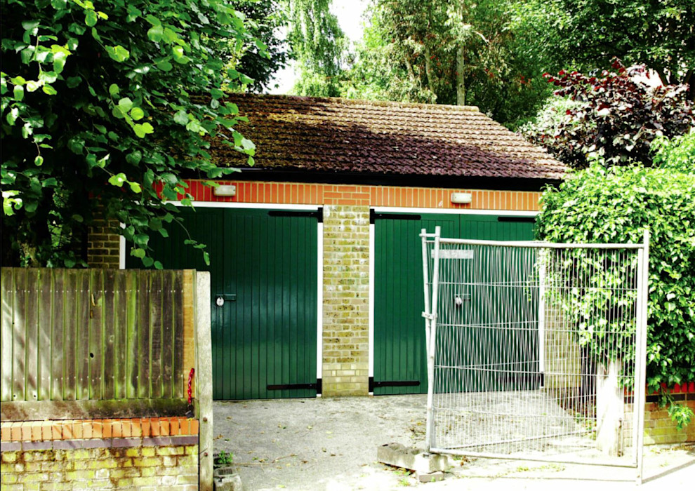Existing double garage that was demolished to create the new house The Crawford Partnership Nhà