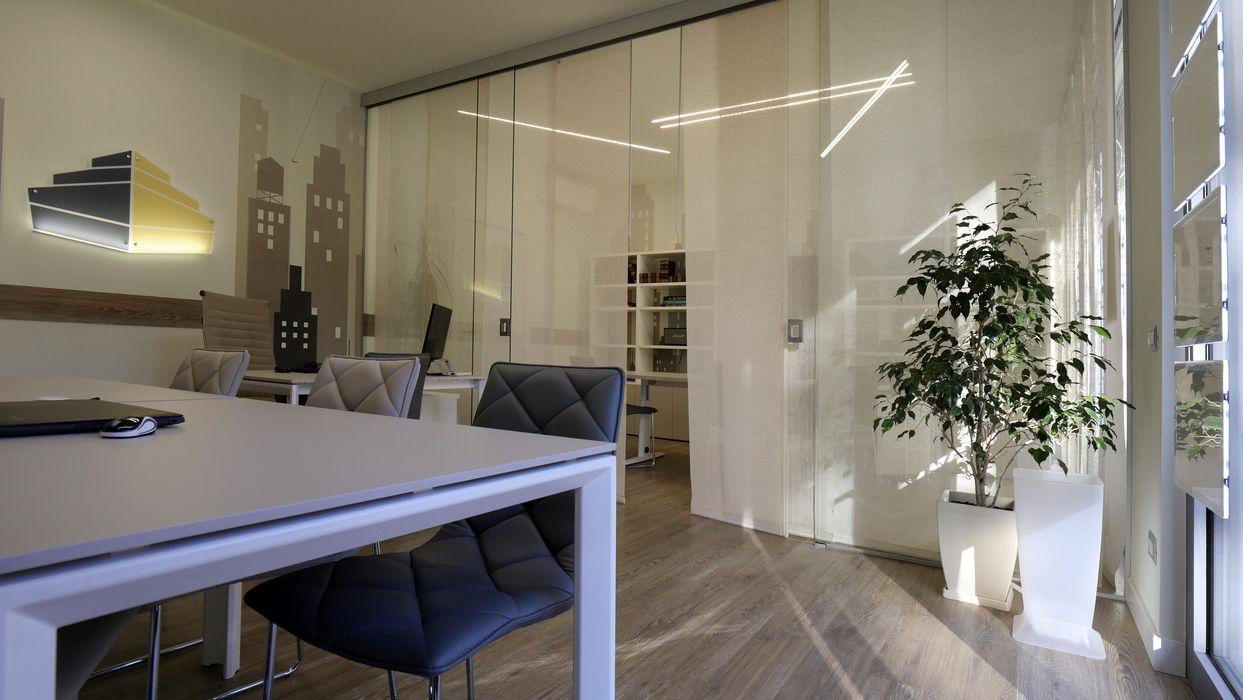 luce e colore Pamela Tranquilli Spazi commerciali in stile minimalista