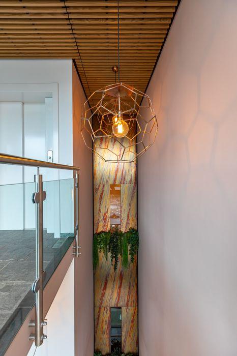 Vide gebouw waterland Aangenaam Interieuradvies Moderne kantoorgebouwen Amber / Goud