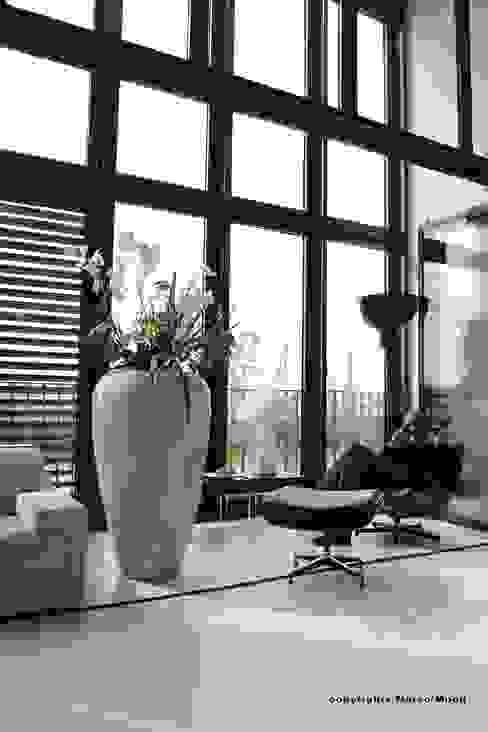 Paredes e pisos modernos por Andras Koos Architectural Interior Design Moderno