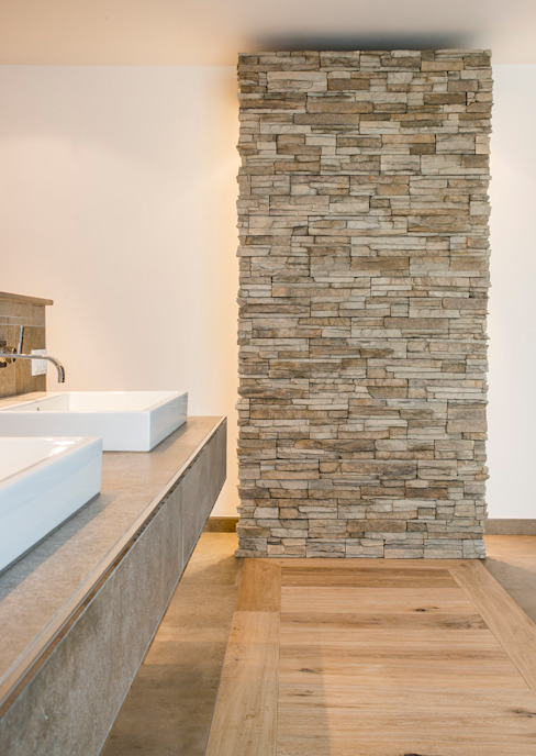 Baños de estilo  por Pientka - Faszination Naturstein, Moderno