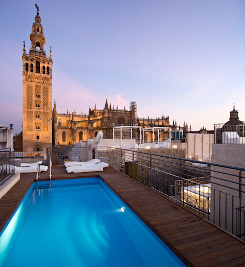 Hotel EME in Seville, Spain Eclectic style pool by Donaire Arquitectos Eclectic