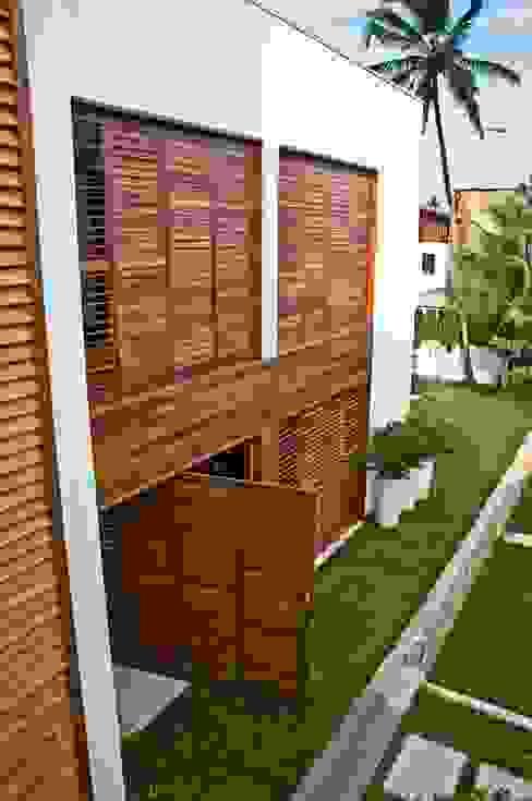 Casas  por homify, Tropical