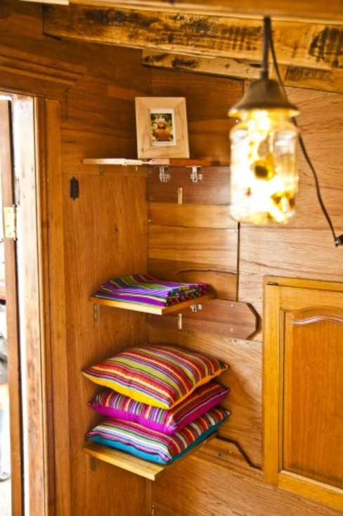Tiny flip down storage options Eclectic style bedroom by The Upcyclist Eclectic
