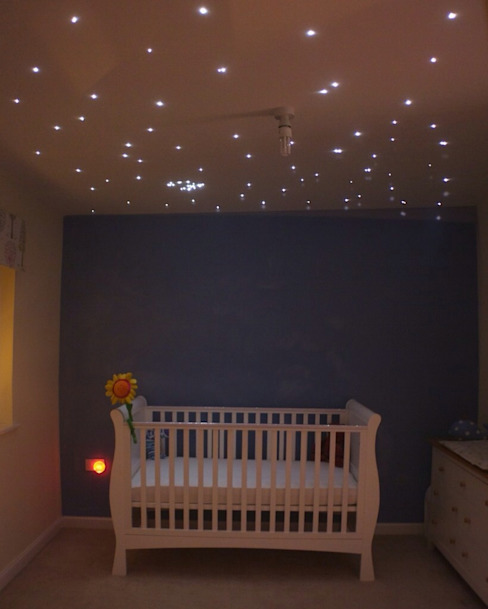 Starlight nursery ceilings Quarto infantil moderno por Lancashire design ceilings Moderno