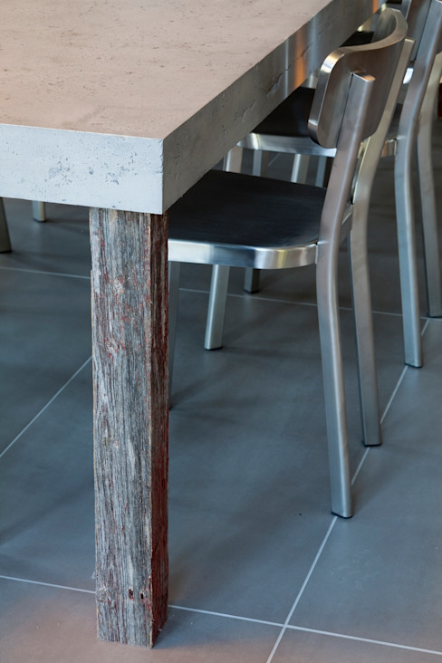 Concrete Table in Chalet Mineral Lodge Scandinavian style dining room by Concrete LCDA Scandinavian