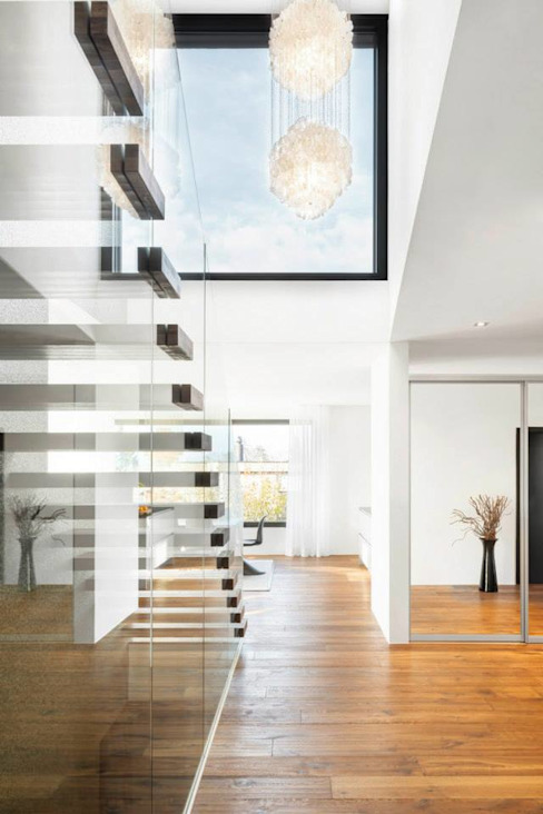 Modern Corridor, Hallway and Staircase by Marty Häuser AG Modern